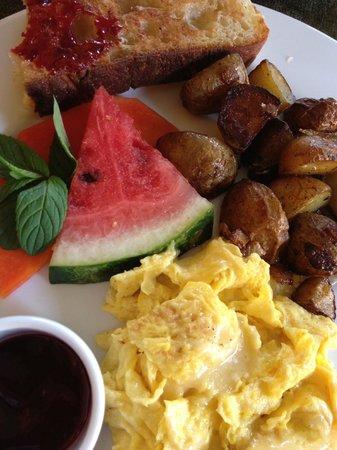 Restaurante Mango at Isla Verde: Scrambled eggs, roasted potatoes, focaccia toast w/cheese-YUM