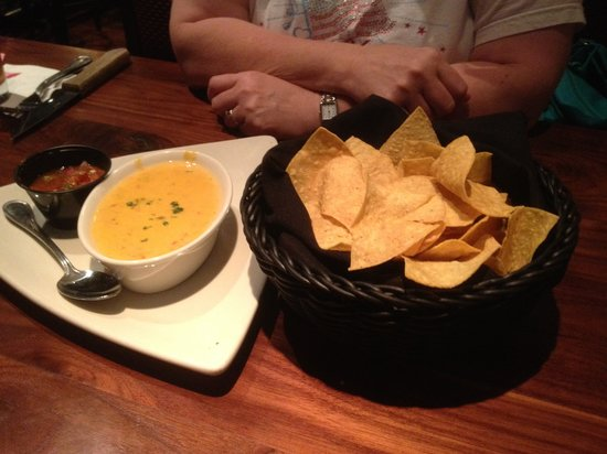 Hollie's Flatiron Steakhouse : Chips, queso and salsa appetizer...chips were crisp and tasty, and the queso was smooth with jus