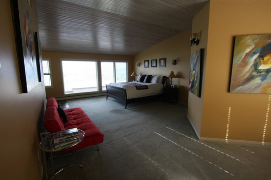 A View of the Lake: Grand View Suite bedroom, with a large bath out of shot to the left
