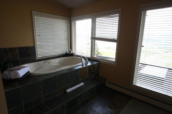 A View of the Lake: Grand View Suite bath, with a great view! Just keep the left blind closed...
