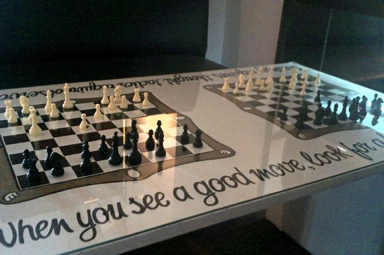"Mango Tree Hostel Bar: Chess Board ""When you see a good move, look for a better one"""