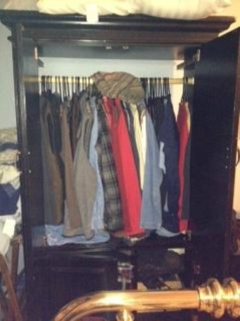 The Town's Inn: The only storage in the room was this armoire already crammed full of someone's winter clothes.