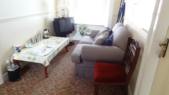 The Village B&B: Lounge with TV and kettle