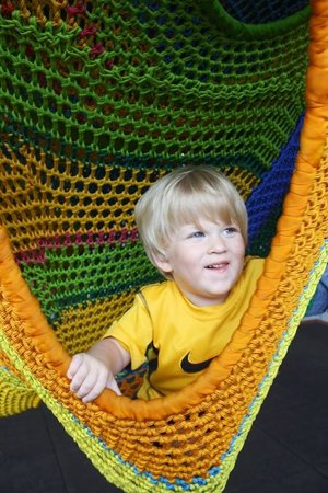 Children's Museum of Winston-Salem: playing in the giant Cacoon outside