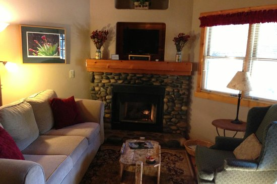 Homestead Cottages: Living Room w/Satelite TV and Fire place