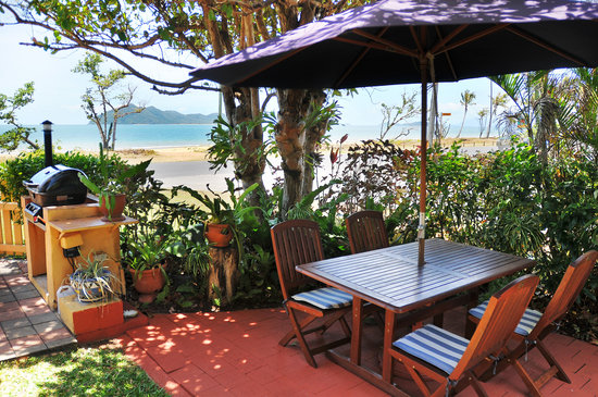 Onna Mission Beachfront Apartments: BBQ and gardens with amazing views