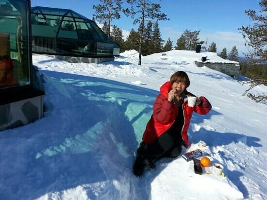 Lapland Safaris: having tea outside the igloo in levi