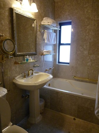 The Iroquois New York: Bathroom tub with window and free standing sink