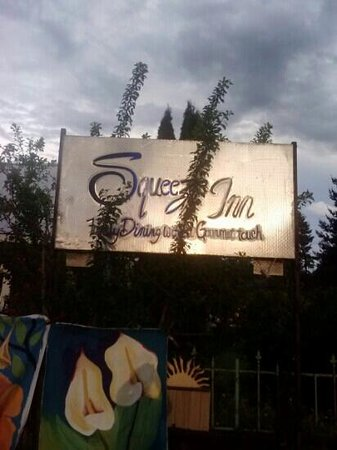 Squeeze Inn: very cool sign, don't miss it.
