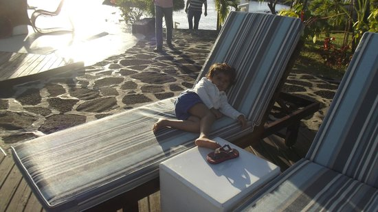 Sands Suites Resort & Spa: my daughter relaxing near the swimming pool