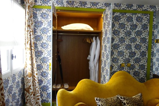 Hotel Thoumieux: Wallpapered closets + nice robes + yellow velvet sofa