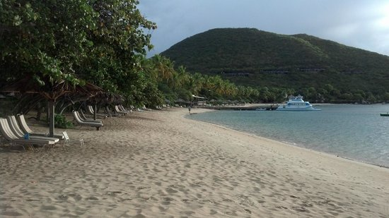 """Rosewood Little Dix Bay: Short walk from our """"private"""" beach to dock & Grill restaurant"""