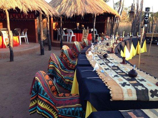 Pan Zam Tourism Project Development Limited - Elephant Oasis Bush Dinners : group dinner setting