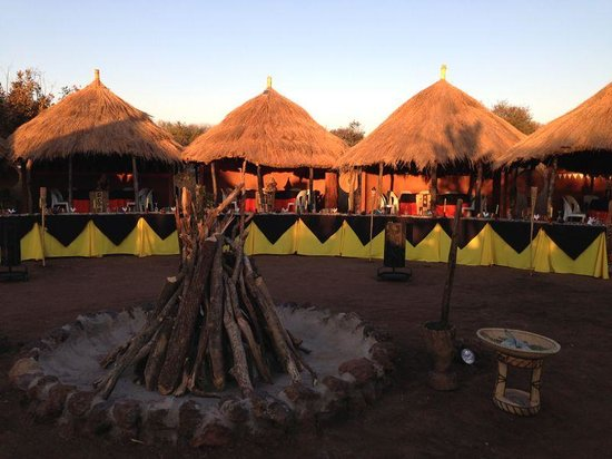 Pan Zam Tourism Project Development Limited - Elephant Oasis Bush Dinners : our village dinner setting