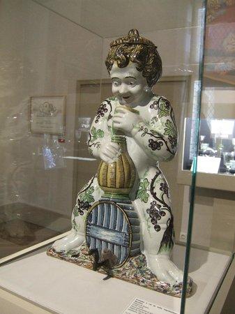 Musée du Vin de Bourgogne : Porcelain figure as featured in the advertising poster