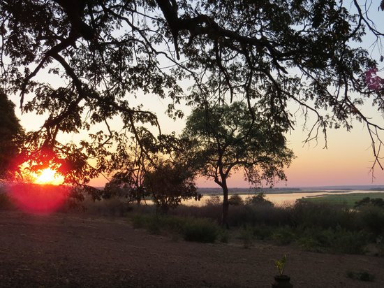 Imbabala Zambezi Safari Lodge: Evening view of river & sunset from front of lodge