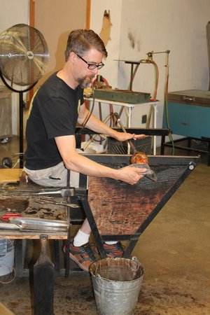The Glass Forge : working ona a vase