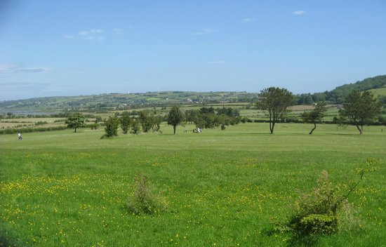 Bentra Golf Course: Mature course, Islandmagee in the distance.