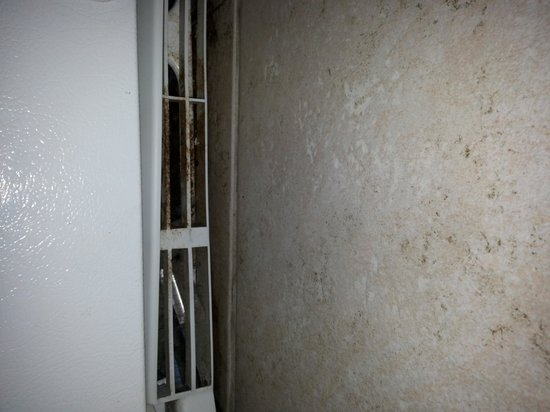Gulf Crest: drainage and grime under and in front of refrigerator