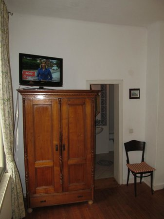 Hotel Drei Kronen; room  with TV on top of cabinet