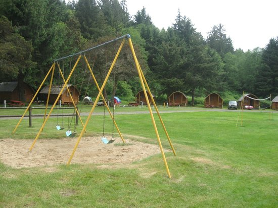 Lincoln City KOA Campground: View of cabins from playground