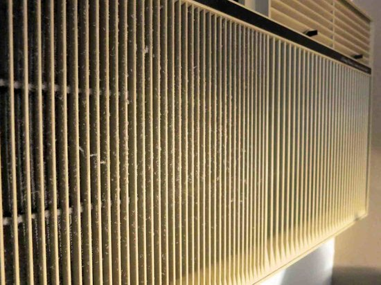 Super 8 Milwaukee Airport: Air conditioner grill, needs a good cleaning