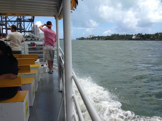 Water Taxi Miami: Water taxi is small pontoon boat with center seats and side aisles.