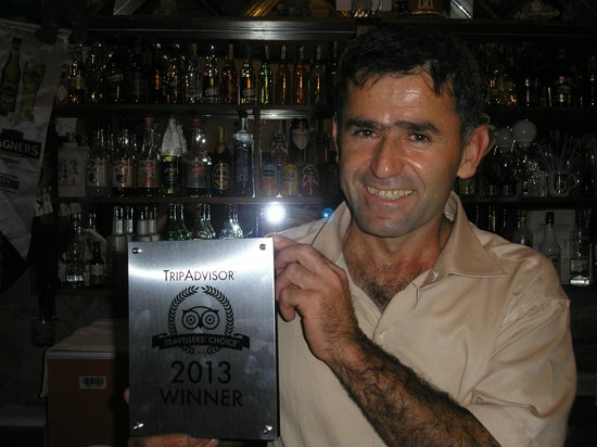 Ozturk Hotel Hisaronu: Naim with his Tripadvisor award