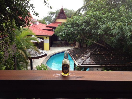 """The Ginger Lily Hotel: """"Relaxing on the porch of our gorgeous room with the local """"Piton Beer""""!"""