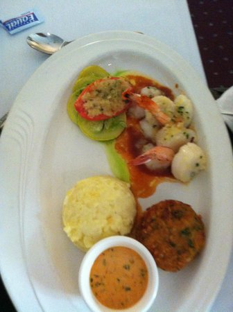 Cafe Michel: Seafood Trio, Scallops, Shrimp and Crab Cake with garlic potatoes and Veggie of the day