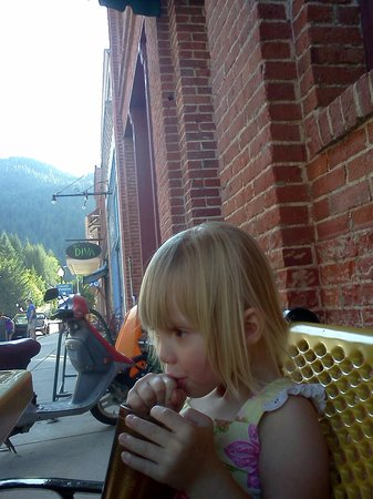 SmokeHouse BBQ & Saloon: Our granddaughter enjoying a huckleberry lemonade at the Smokehouse.