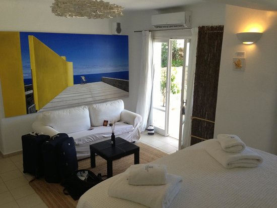 Rocabella Mykonos Art Hotel & SPA: half of our room:) 103 - really recommend this room - beautifully furnished and great balcony ar