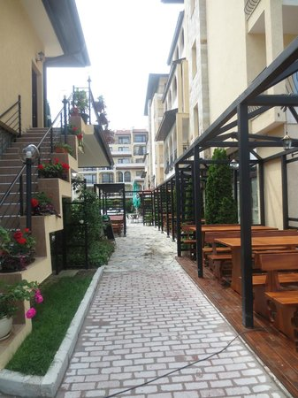 Rose Village Apartments: Side of Restaurant, with outside dining area