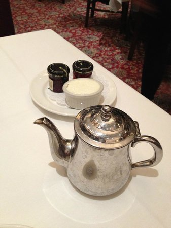 Capital Grille : Two tiny jars of raspberry and strawberry jelly, butter, and pot of tea