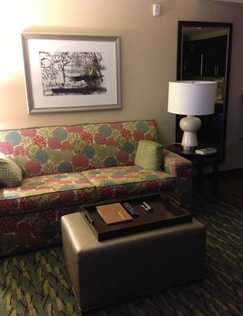 Homewood Suites by Hilton Orlando Airport: Comfortable seating. Convenient coffee table/ottoman combination. Excellent lighting.