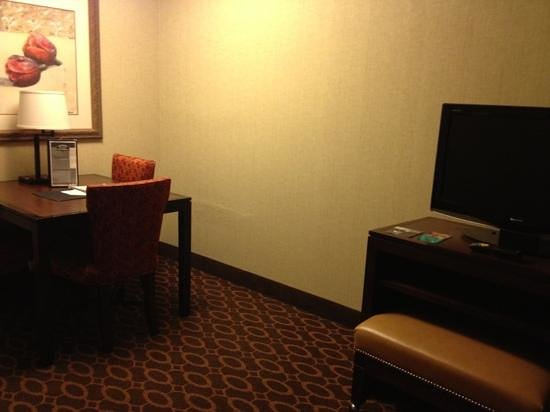 Embassy Suites by Hilton Charlotte : extra sitting area and tv in living room. nice ottoman