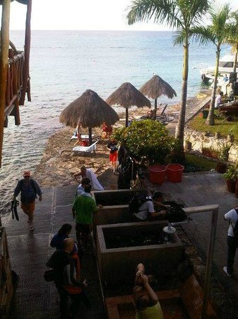 Blue Angel Resort: View from restaurant staircase to diving shop & gear cleaning area