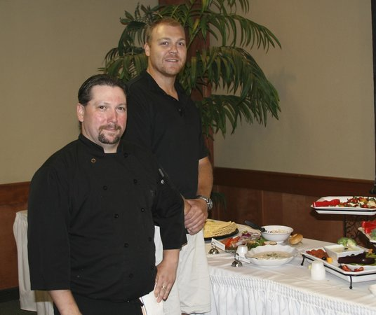 Spurs Bar & Grill: Chef, Tom on left. Bret, co-owner on right at reception