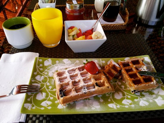 Physis Caribbean Bed & Breakfast : Emily's blueberry waffles with coconut rum syrup