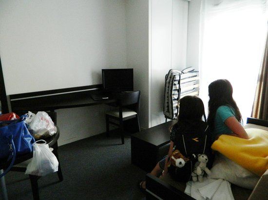 Nemea Nancy Appart'Hotel : room with sofa closed