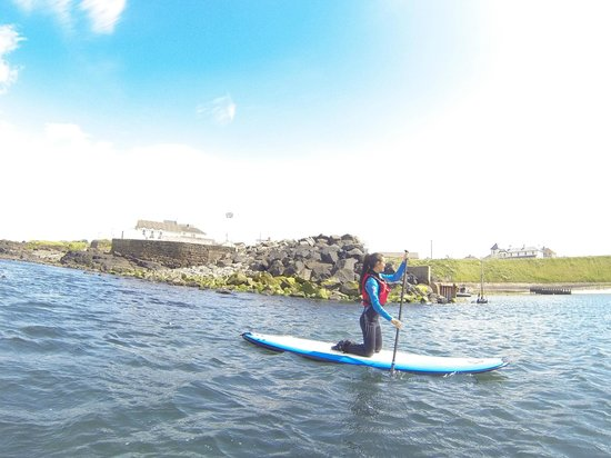 Surf Sup NI: Wind trying to push me back out as I paddled in the harbor.