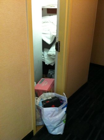 Renaissance New York Hotel 57: The view across the hall from our room, door never closed, trash bag and pile of wet dirty towel