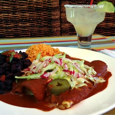 Enchiladas de Queso are drenched in an ancho chile sauce