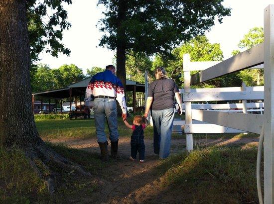 Wolf Lake Ranch Resort: Family walking by paddocks