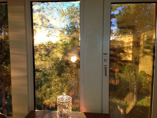 "Healy Heights Family Cabins: ""Sunset"" through the North Ridge cabin windows"