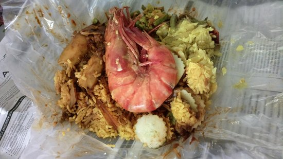 Nasi Kandar Line Clear: Packet of rice with hugh prawn, squid and fish roe
