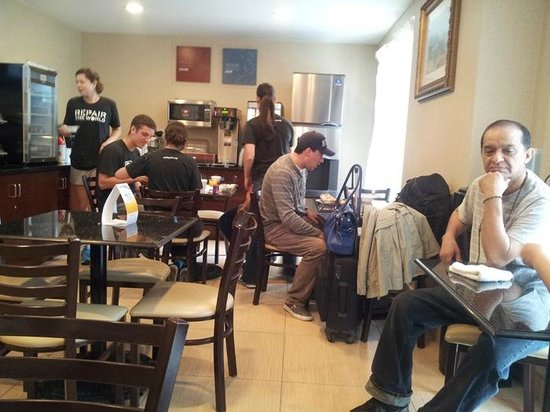Comfort Inn Brooklyn: Employees should work, not hang around the breakfast room