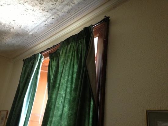 The Anchorage Hotel: curtains hanging off rail
