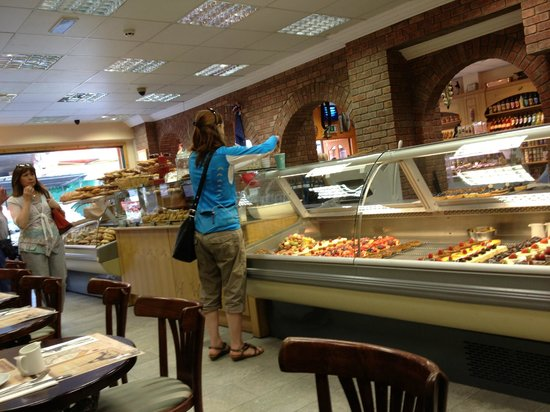 Paris Bakery and Pastry : The breakfast tables are opposite the pastry displays.  Impossible to leave here without a pastr
