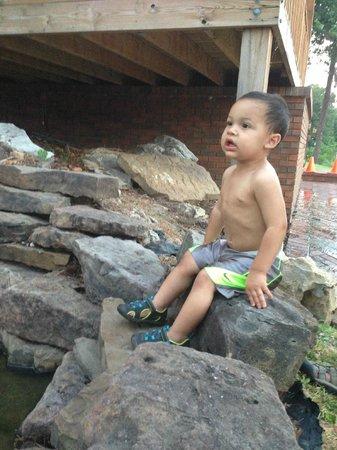 Candlewyck Cove Resort: My grandson enjoying the waterfall.